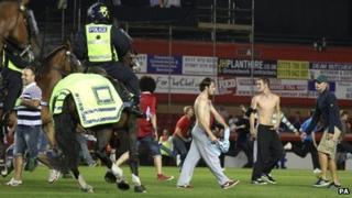 Riot Police on horseback clear the pitch at Ashton Gate