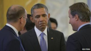 US President Barack Obama speaks with Italian Prime Minister Enrico Letta and British Prime Minister David Cameron at the G20 Summit in St. Petersburg on 6 September 2013