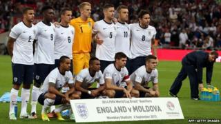 England team pose for photos