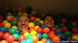 Sir Patrick Stewart in a ball pool with Sunny Ozell