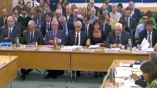 (Left to right) Former BBC director general Mark Thompson; Marcus Agius, former chairman of the BBC executive board remuneration committee; Sir Michael Lyons, former Trust chairman; Nicholas Kroll, director of BBC Trust; Lucy Adams, BBC HR director; Lord Patten, BBC Trust chairman; and Anthony Fry, BBC Trust member, sit before the Commons Public Accounts Committee in London on 9 September 2013