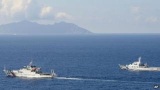 A China coast guard vessel, left, is followed by a Japan coast guard ship as it sailed near the disputed East China Sea islands called Senkaku by Japan and Diaoyu by China, 10 September 2013
