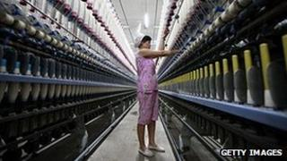 A woman in a Chinese textile factory