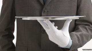Butler holding tray (stock picture)