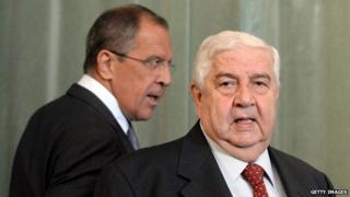 Syrian Foreign Minister Walid Muallem (R) and his Russian counterpart Sergei Lavrov (L) walk to a press conference