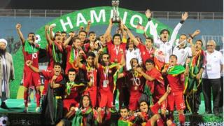 Afghan team celebrate winning the South Asian Federation Championship after defeating India 2-0 on 11 September 2013