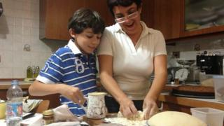 Giovanna Azi cooks with her son