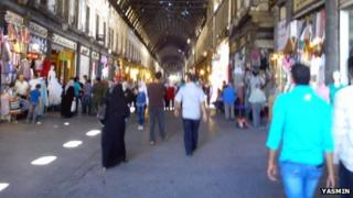 Syrians shop at Al-Hamidiyah Souq in Damascus