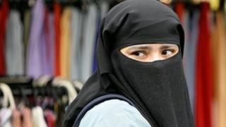 Young woman in London wearing a niqab