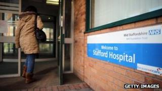 Person walking into Stafford Hospital in February 2013