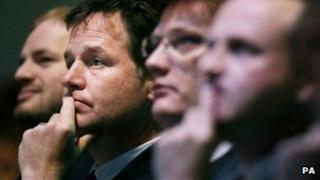 Nick Clegg, Danny Alexander and Steve Webb in the conference hall
