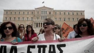 Protesters shout slogans during a rally by high school teachers against layoffs in their sector in front of the parliament in Athens (16 September)