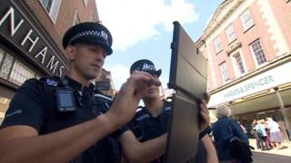 Cambridgeshire Police with tablet