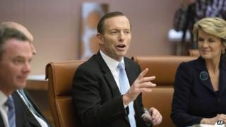 Australia's new Prime Minister Tony Abbott, centre, leads the first meeting of his full ministry in the Cabinet Room of Parliament House