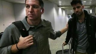 Glenn Greenwald (left) and his partner David Miranda (right) were reunited when Mr Miranda arrived back in Brazil