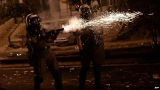 Greek riot police fire tear gas towards protesters during clashes in Athens on September 18, 2013.