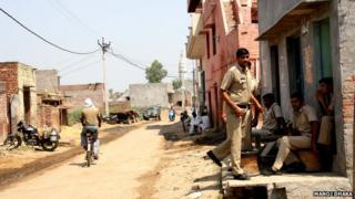 Police at the scene of the crime in Rohtak