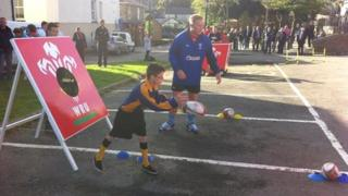 Youngster playing rugby