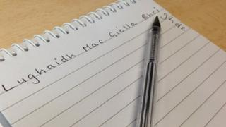 Mr Mac Giolla Bhrighde's name written across a notebook