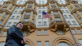 A Russian police officer patrols a street in front of the US Embassy in Moscow