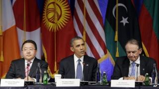 US President Barack Obama, Mongolia's President Tsakhiagiin Elbegdorj and Deputy Secretary-General of the United Nations Jan Eliasson appear at a roundtable event in New York on 23 September 2013