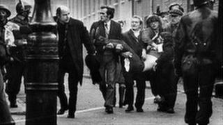 People carrying body of injured man on Bloody Sunday