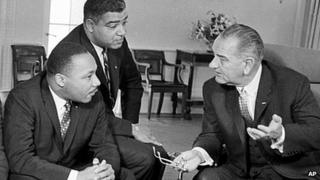 President Lyndon Johnson, right, with Martin Luther King, left, and Whitney Young,