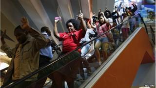 Civilians escape the Westgate shopping centre in Nairobi