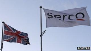 A Serco flag flying alongside a Union Flag