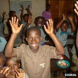Deaf boy waving his hands