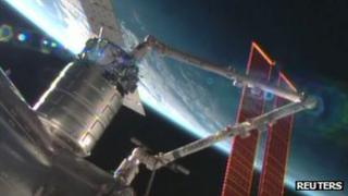 Cygnus cargo ship docking with International Space Station
