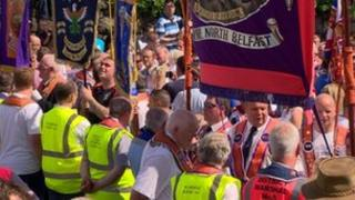 The parade was prevented from marching past Ardoyne shops in July