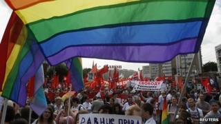 Gay rights activists march through Moscow in June 2013