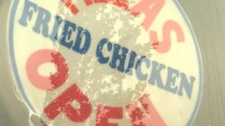 Pizza and fried chicken sign in Hull takeaway window