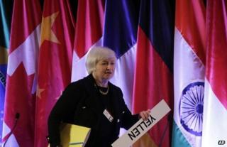 Janet Yellen with her name sign