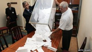 Tajik election officials empty a ballot box after the 2006 presidential election