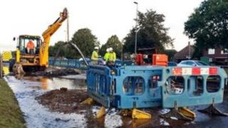 Workmen on flooded A18, Scunthorpe