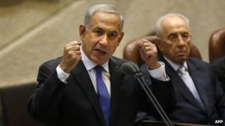 Israeli Prime Minister Benjamin Netanyahu delivers a speech during the opening of the Knesset (Israel's parliament) winter session