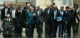 Angela Merkel (centre) leads her party to talks with the Greens in Berlin, 15 October