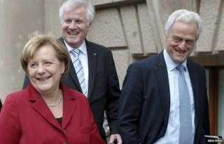 Angela Merkel and her CSU allies (from left) Horst Seehofer and Peter Ramsauer leave talks with the SPD in Berlin, 17 October