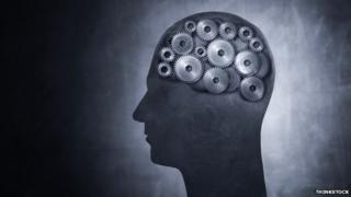 Image of a human head with cogs