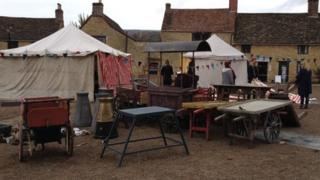 """Market stalls"" on the set outside Sherborne Abbey"