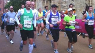 Runners passing York Minster