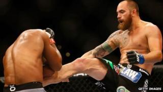 Travis Browne kicks Alistair Overeem in their heavyweight bout in August