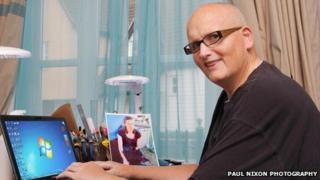 Paul Mason at his computer