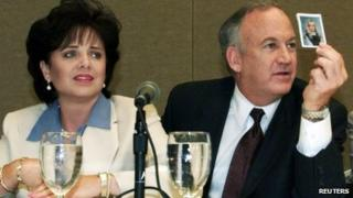 Patsy Ramsey and her husband, John Ramsey, produce a picture of JonBenet Ramsey during a press conference where they released the results of an independent lie detector test in Atlanta 24 May 2000