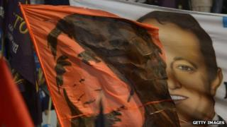 Flags with the faces of President Cristina Fernandez de Kirchner and Martin Insaurralde are seen during the closing of the election campaign in Buenos Aires province on 24 October, 2013
