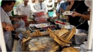 Mexican street vendors sell fried food