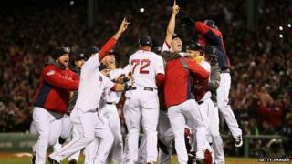 The Boston Red Sox celebrate after defeating the St Louis Cardinals in the 2013 World Series at Fenway Park on in Boston, Massachusetts, on 30 October 2013