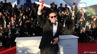 Mexican director Amat Escalante poses after being awarded Best Director award at Cannes, 26 May 2013